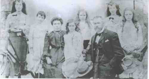 The Kiernan family (from left) Lily, Helen, Bridget, Maud, Catherine, Peter, Rose, Christine, and Larry's foot in stirup